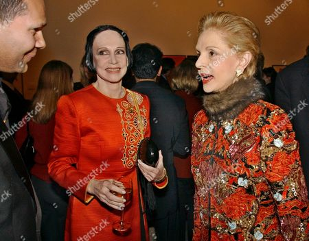 """HERRERA MCFADDEN Designers Carolina Herrera, right, and Mary McFadden, talk with an unidentifed man at a receptioon to celebrate the launch of Herrara's new fragrance """"Chic,"""" during Fashion Week in New York Thursday night"""