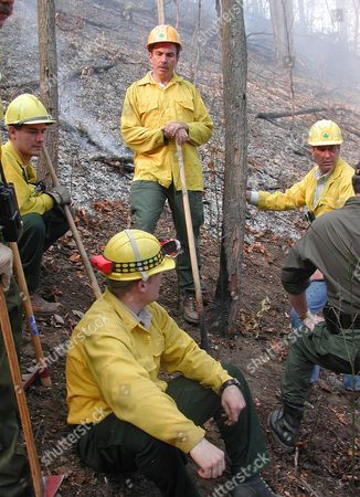 WILDMAN Gov. Bob Wise, top center, works with fire fighting crews to help control forest fires near Dingess, W.Va. . Also pictured are the Division of Forestry's Juergen Wildman, left, John Bird, center, and Director of Forestry Charles Dye, right. West Virginia National Guard troops could be on the fire lines by week's end as Gov. Wise has declared a state of emergency following an outburst of wild fires across the state, officials said Wednesday