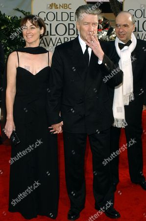 """SWEENEY LYNCH Writer and director David Lynch, center, arrives with producer Mary Sweeney at the 59th Annual Golden Globe Awards in Beverly Hills, Calif., . Their film, """"Mulholland Drive,"""" is nominated for best motion picture drama, and Lynch is nominated for best director"""