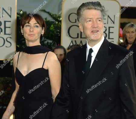 """SWEENEY LYNCH Writer and director David Lynch arrives with producer Mary Sweeney at the 59th Annual Golden Globe Awards in Beverly Hills, Calif., . Their film, """"Mulholland Drive,"""" is nominated for best motion picture drama, and Lynch is nominated for best director"""