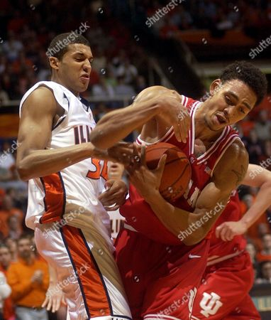 COOK, JEFFERIES Illinois' Brian Cook, left, and Indiana's Jared Jeffries battle for a rebound during the first half, in Champaign, Ill