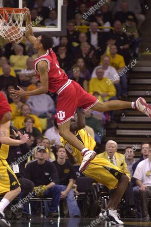 JEFFRIES WORLEY Indiana's Jared Jeffries, top, dunks the ball over Iowa's Glen Worley during the first half, Sunday afternoon, in Iowa City, Iowa. Worley was called for a foul on the play