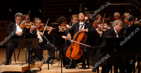PERLMAN MA AX Violinist Itzhak Perlman, left, cellist Yo-Yo Ma, center, and pianist Emanuel Ax, right, perform Beethoven's Triple Concerto in C Major, Opus 56 at the Philadelphia Orchestra's inaugural concert, at the $265 Million glass-and-brick Kimmel Center for the Performing Arts Center in Philadelphia