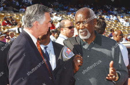 HAHN HOLDEN Los Angeles City Councilman Nate Holden, right, speaks with Los Angeles Mayor James Hahn during the Black Baseball Players Association Game of the Century, at Dodger's Stadium, in Los Angeles. The stadium crowd of mostly black spectators booed Hahn when he spoke at the event because of Hahn's stance on the reappointment of Los Angeles Police Chief Bernard Parks