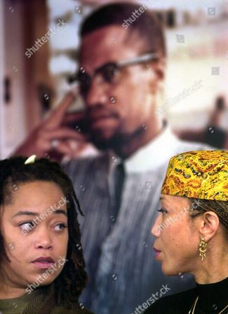 Stock Photo of SHABAZZ Malaak Shabazz, left, talks with her sister Attallah Shabazz during a press conference at the New York Public Library's Schomburg Center for Research in Black Culture in Harlem, New York, . The Shabazz family has placed a collection of Malcolm X's diaries, photos, letters, and other materials on long term loan with the center. The collection was discovered online at Ebay and pulled from auction after the family protested