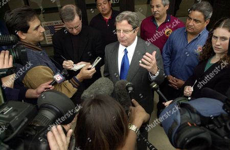 SANCHEZ Democratic gubernatorial hopeful Tony Sanchez, center, is surrounded by media as he stops at a San Antonio Fire Station in San Antonio, . Dan Morales, also a Democratic gubernatorial hopeful, criticized opponent Sanchez for his big-spending ways Tuesday