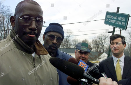 MICHAEL AUSTIN Michael Austin, left, answers reporters questions after being released from the Maryland House of Correction where he has spent the last 27 years in Jessup, Md., . Next to Austin, from left, are his brother Harold Austin, James McCloskey, executive director of Centurian Ministries, and his lawyer Larry Nathans, right. Austin was released on $10,000 bail and will get a new trial after a judge overturned his 1974 murder conviction for lack of evidence