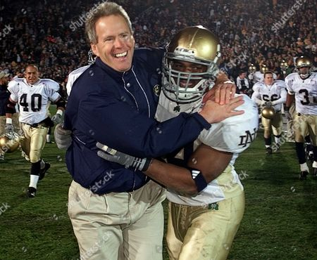 DAVIE OWENS Notre Dame coach Bob Davie, left, hugs John Owens as he leads the team off the field following a 24-18 win over Purdue in West Lafayette, Ind
