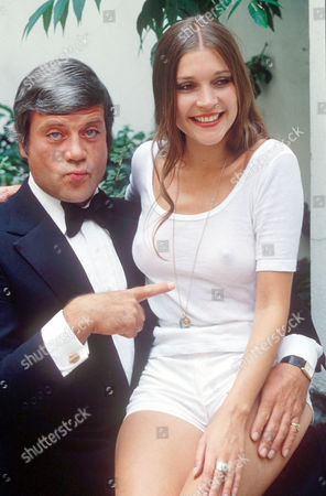 OLIVER REED AND JUDY BUXTON