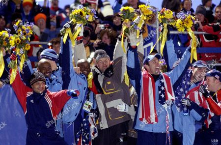 Bobsled medalists celebrate during the flower ceremony after the men's four-man bobsled final at the 2002 Salt Lake City Winter Olympics in Park City, Utah, . Seen are from left to right, Bill Schuffenhauer, Randy Jones, Todd Hays, Garrett Hines, all of the United State; Germany's Andre Lange, and the United States' Brian Shimer, Mike Kohn and Doug Sharp