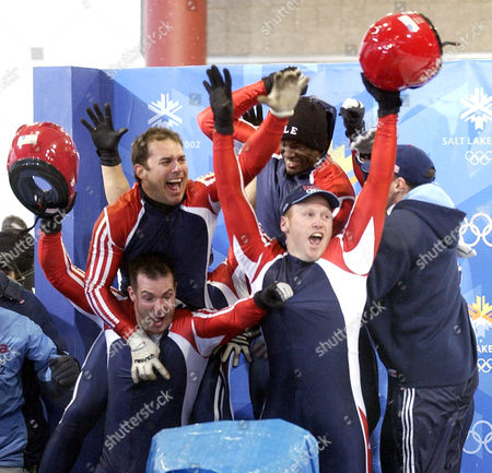 Hines Steele Kohn Shimer Members of the United States bobsled teams react after seeing that the Switzerland-1 sled did not beat them during the men's four-man bobsled final at the 2002 Salt Lake City Winter Olympics in Park City, Utah, . Seen are Brian Shimer, top left, Garrett Hines, of USA-1, top right, Mike Kohn, bottom left, and Dan Steele, bottom right. USA-1 won the silver medal, and USA-2 won the bronze
