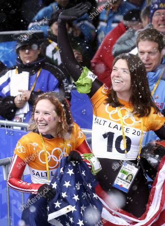 Stock Photo of GALE PARSLEY Gold medalist Tristan Gale, 21, of New Mexico, left, and silver medalist Lea Ann Parsley, 33, a firefighter from Granville, Ohio, react to the crowd after the women's skeleton final at the Salt Lake City Winter Olympics in Park City, Utah