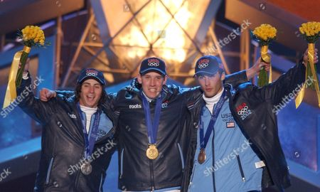 POWERS KASS THOMAS The American medalists, gold medalist Ross Powers, center, flanked by silver medalist Danny Kass, left, and bronze medalist J.J. Thomas, right, in men's halfpipe snowboarding rejoice on stage after receiving their medals at Medals Plaza in downtown Salt Lake City