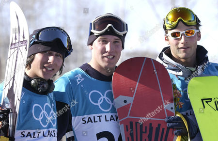 POWER KASS THOMAS Silver medalist Danny Kass, left, gold medalist Ross Powers and bronze medalist J.J. Thomas stand together at the finish in the men's Olympic halfpipe competition in Park City, Utah on . All are members of the U.S. team, which swept the competition in medals