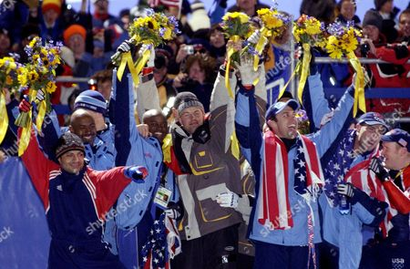 US BOBSLED TEAM Bobsled medalists celebrate during the flower ceremony after the men's four-man bobsled final at the 2002 Salt Lake City Winter Olympics in Park City, Utah, . Seen are from left to right, Bill Schuffenhauer, Randy Jones, Todd Hays, Garrett Hines, all of the United State; Germany's Andre Lange, and the United States' Brian Shimer, Mike Kohn and Doug Sharp