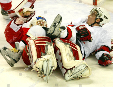 FLEURY HASEK Canada's Theo Fleury falls on top of Czech Republic goalie Dominik Hasek during the third period of their Salt Lake City Winter Olympic hockey match, in Kearns, Utah. The game ended in a 3-3 tie