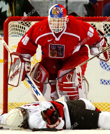 HASEK FLEURY Czech Republic goalie Dominik Hasek (39) stares down on a fallen Theo Fleury of Canada following a collision in the third period of their Olympic match in the Salt Lake City Winter Olympics, in Kearns, Utah. The game ended in a 3-3 tie