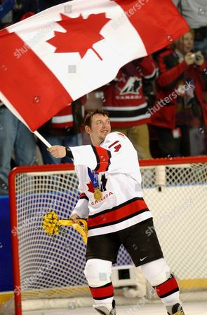 FLEURY Theo Fleury of Canada waves the Canadian flag after the awards ceremony for gold medal hockey game against the United States at the Winter Olympics in West Valley City, Utah, . Canada defeated the US 5-2 to capture the gold