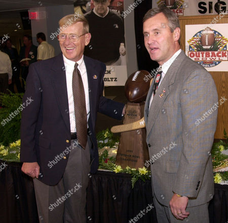 HOLTZ TRESSEL South Carolina coach Lou Holtz, left, stands with Ohio State coach Jim Tressel and the Outback Bowl trophy at a contract signing party at Raymond James Stadium in Tampa, Fla., . The two teams will meet in the Outback Bowl on Jan. 1, 2002