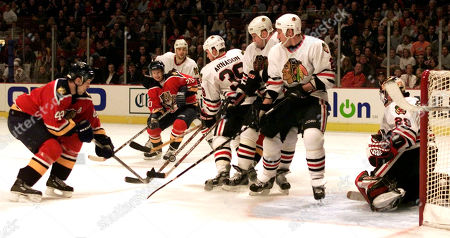 BURE Chicago Blackhawks (from right) goaltender Steve Passmore (29), Jaroslav Spacek, from the Czech Republic, Alexander Karpovtsev, from Russia, and Tyler Arnason (39) line up to block Florida Panthers' Sandis Ozolinsh, left, from Latvia, and Valeri Bure (20), from Russia from making a shot in the third period in Chicago. The Blackhawks beat the Panthers 5-4