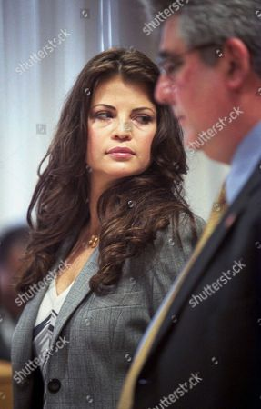 "Stock Photo of YASMINE BLEETH Former ""Baywatch'' star Yasmine Bleeth, left, stands with attorney Jerome Sabbota, right, in a court in the Frank Murphy Hall of Justice in Detroit. On Wednesday, Jan. 9, 2002 Bleeth was sentenced to two years probation on a cocaine-possession charge. The sentencing also calls for the actress to undergo regular drug tests, serve 100 hours of community service and pay court costs, said Christopher Coyle, a deputy chief trial attorney for the Wayne County Prosecutor's Office"