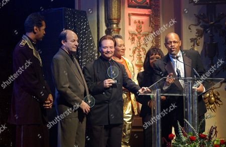 """STEWART Members of """"Sly and the Family Stone"""" accept a Pioneer Award at New York's Apollo Theatre, . From left are Larry Graham, Greg Errico, Jerry Martini, Cynthia Robinson, and Sly Stone's sister and brother, Rosie and Freddie Stewart. The Pioneer Awards recognize those who have made a deep impact on the development of rhythm & blues. Sly Stone did not attend the event"""