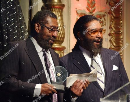 HOLLAND Brian Holland, left, and his brother, Eddie, accept a Pioneer Award at New York's Apollo Theatre, . The Pioneer Awards recognize those who have made a deep impact on the development of rhythm & blues