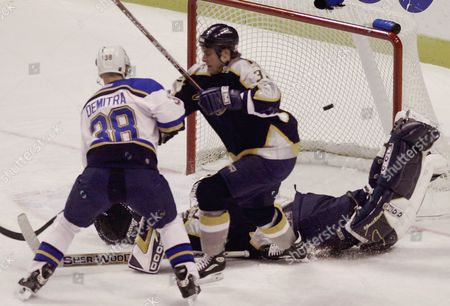 DEMITRA HULSE VOKOUN St. Louis Blues' Pavol Demitra, left, watches as his shot sails into the goal against Nashville Predators' Cale Hulse, center, and goalie Thomas Vokoun during the first period, in St. Louis