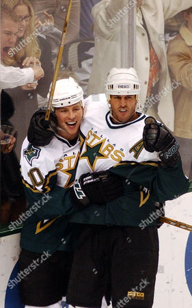 MODANO MORROW Dallas Stars center Mike Modano, right, is congratulated by teammate Brenden Morrow (10) after scoring the go-ahead goal against the New York Rangers during the third period of their game Wednesday night, in Dallas. Dallas won 4-2