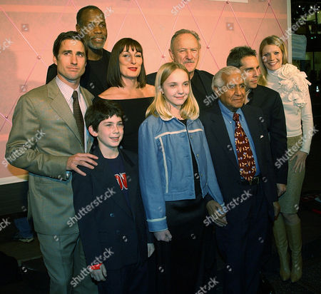 """HUSTON Cast members of """"The Royal Tenenbaums"""" pose together at the premiere of the film in the Hollywood section of Los Angeles, . From left are Luke Wilson, Jonah Meyerson, bottom left, Danny Glover, top left, Anjelica Huston, Irene Gorovaia, Gene Hackman, Kumar Pallana, Ben Stiller and Gwyneth Paltrow"""