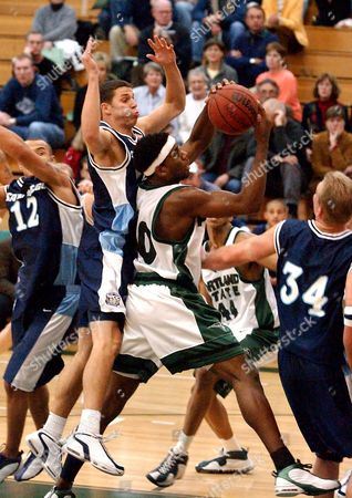 BLAIR Portland State's Anthony Lackey, center, works against San Diego defenders, from far left, Andre Laws, Matt Delzell and Jason Blair, right, during the first half, in Portland, Ore
