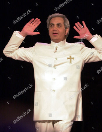 BENNY HINN Evangelist Benny Hinn, raises his hands in prayer during a service at the Blaisdell Concert Hall in Honolulu, Hawaii, . But while others like Jimmy Swaggart, Jim Bakker and Robert Tilton have fallen from grace over the past two decades, Hinn plows ahead, relentlessly seeking souls and money