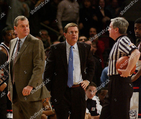 CALHOUN BLANEY CAHILL Connecticut head coach Jim Calhoun, left, looks back at referee John Cahill, right, as he gets ejected after receiving two technical fouls during the first half at New York's Madison Square Garden, . Assistant coach George Blaney, center looks on