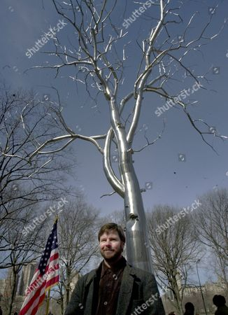 """PAINE Roxy Paine stands in front of the """"Bluff,"""" the 50-foot high tree he created of reflective stainless steel after it was installed in New York's Central Park . Mayor Michael Bloomberg kicked off the biennial of the Whitney Museum of American Art which will be observed both inside the museum and in Central Park with the work of five artists in the park and 113 artists and collaborative teams inside the museum"""