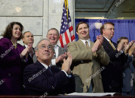 RICHARDS Gov. Paul Patton, lower-left, is joined by other government officials as he applauds during a ceremony held to sign a telemarketing bill, at the Capitol in Frankfort, Ky. The bill is designed to let people shield themselves from unwanted telemarketing calls. From left in the background are Rep. Tanya Pullin, D-South Shore, Lt. Gov. Steve Henry, Rep. John Adams, D-Hopkinsville, Rep. Charles Hoffman, D-Georgetown, and House Speaker Jody Richards, D-Bowling Green
