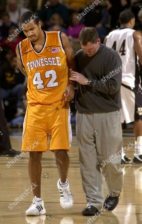 HIGGINS NEWMAN Tennesse guard Jon Higgins (42) is helped off the court by trainer Chad Newman after Higgins injured his back in the second half against Vanderbilt, in Nashville, Tenn. Tennessee won 67-65