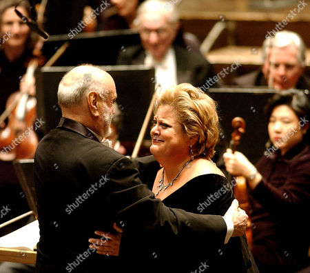 """MASUR VOIGHT Kurt Masur, left, conductor of the New York Philharmonic, hugs soprano Deborah Voigt after completing a performance of Wagner's Tristan and Isolde at New York's Avery Fisher Hall, . The New York Philharmonic billed this season as """"Thank you, Kurt Masur."""" It was a chance to say farewell to the towering maestro who took over as music director on Sept. 11, 1991, tamed an ensemble of egos and held the post longer than anyone except Zubin Mehta. Then came Sept. 11, 2001. Next came a failing kidney"""