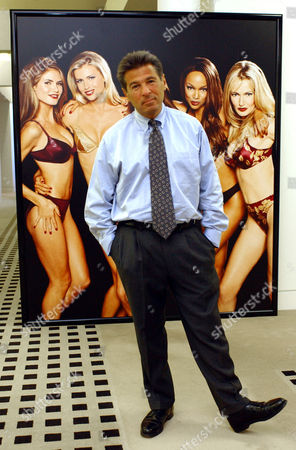 RAZEK Ed Razek, marketing director for Victoria's Secret, poses for a photo in front of a poster in his Columbus, Ohio, office . Razek is the creator behind the sexy lingerie ads that have appeared on television for years and the annual fashion show that crashed the Victoria's Secret Web site the first time it appeared because it was so popular
