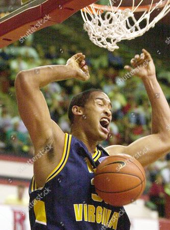 Stock Photo of MOSS West Virginia's Chris Moss scores a basket against Rutgers during the first half at the Louis Brown Athletic Center in Piscataway, N.J