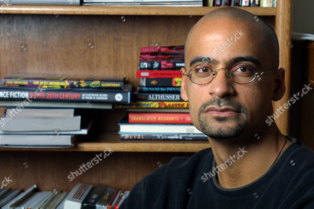 """DIAZ Writer and Syracuse University professor Junot Diaz poses for a portrait in his Syracuse, N.Y., apartment . Success has come quickly to the 33-year-old Dominican native, who was in his mid-20s when his story collection """"Drown"""" made him one of the most admired young writers"""