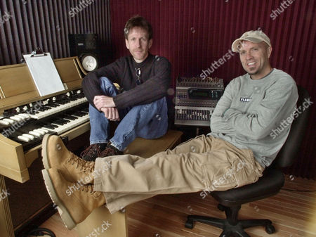 "MILLER HUBBARD Lead singer Mark Miller, right, and keyboardist Gregg Hubbard, left, of the group Sawyer Brown are shown in Miller's home recording studio in Franklin, Tenn., . Twenty years after their founding, Sawyer Brown is intact except for one personnel change and is releasing their 18th album ""Can You Hear Me Now"" on June 11. They'll perform about a hundred concerts this year"