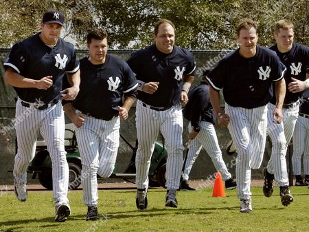 GIAMBI COOMER LEYRITZ From left, Jason Giambi, Ron Coomer and Jim Leyritz runs with other Yankees, at the team's first full squad workout at Legends Field in Tampa, Fla. Giambi is the team's new first baseman. Coomer is also an infielder. Leyritz, already a Yankee twice in the pasts, was signed to a minor league contract Tuesday