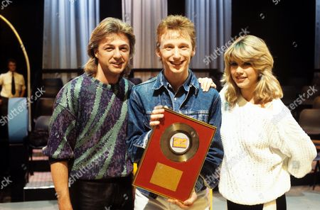 Gary Crowley (centre) with Bobby Gee and Shelley from Bucks Fizz in 'Poparound' - 1985