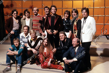 'Greatest Hits' 1982 Mike Smith (front row 3rd left) with some of the pop stars from the show. Including - Dave Dee, Dozy, Beaky, Mick and Titch, John Gorman and Mike McGear (The Scaffold), Mary Hopkin, Steve Ellis