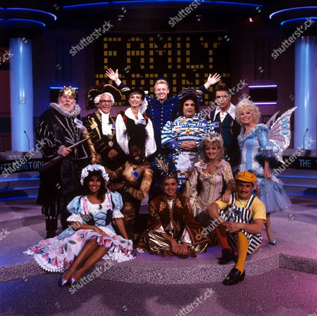 'Family Fortunes' - 1990 (back line) Windsor Davies, Barry Cryer, Marti Caine, Les Dennis, Russell Grant, Brian Conley and Barbara Windsor.(front line) Linda Lusardi, Floella Benjamin, Wayne Dobson, Bernie Nolan and Barry McGuigan.