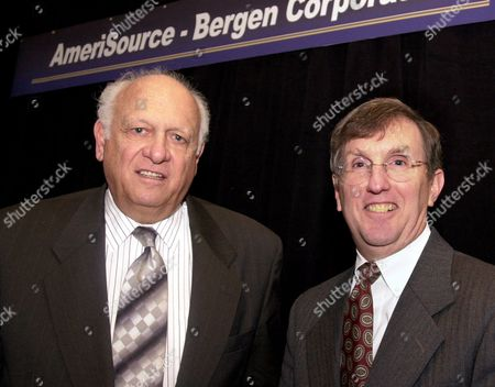 MARTINI YOST Robert E. Martini, left, chairman and CEO of Bergen Brunswig Corp., poses with R. David Yost, chief executive officer of AmeriSource Corp., at a news conference in New York, to announce that AmeriSource is acquiring Bergen in a $2.4 billion deal that will combine two of the nation's largest drug distributors