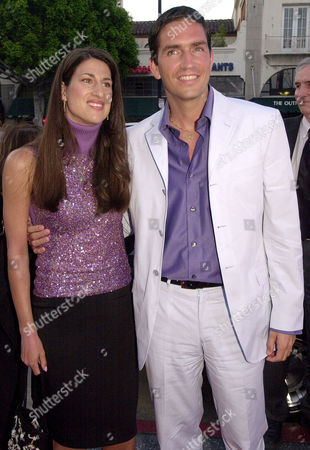 """CAVIEZEL Actor Jim Caviezel arrives with his wife, Kerri Caviezel for the premiere of his movie """"Angel Eyes,"""", in the Hollywood area of Los Angeles"""