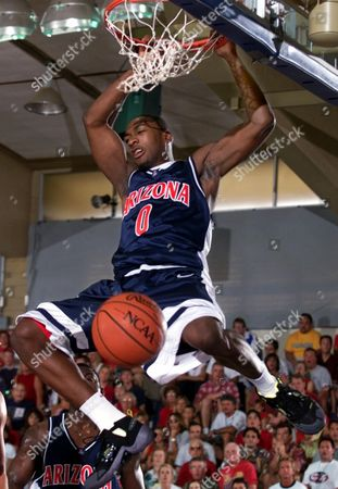 ARENAS Arizona guard Gilbert Arenas gets the slam dunk on an alley-oop play as they played Chaminade in the first half of an opening round game of the Maui Invitational in Lahaina, Hawaii