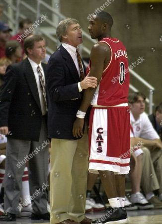 ROSBOROUGH ARENAS Arizona's assistant basketball coach Jim Rosborough, center, talks with player Gilbert Arenas during the second half against Connecticut in Storrs, Conn., . Rosborough was filling in for head coach Lute Olson who chose the stay at home with his wife Bobbi while she undergoes treatment for ovarian cancer