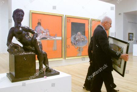 """TANCOCK John Tancock, a senior specialist in Sotheby's Impressionist and Modern Art department, carries Joan Miro's """"Nocturne,"""", as he passes """"Figure Decorative,"""" a sculpture by Henri Matisse, and """"Studies of the Human Body"""" by Francis Bacon, during a preview of the auction house's upcoming sales. Stock market volatility and a sluggish economy have made art dealers jittery as they head into next week's major spring auction sales"""